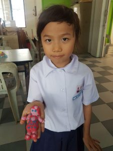 P2 students take pride in their artworks.