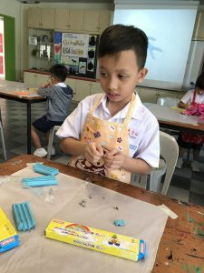 P2 students experience with plasticine to create sculptures.
