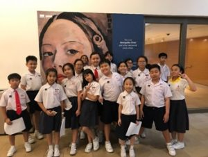 Students excited in front of the famous Georgette Chen's poster.