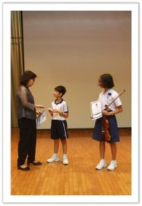 The performers receiving their certificates after their performances.
