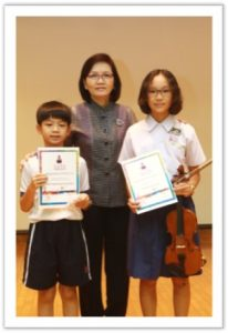 Chongfu many talents with our Principal, Mdm Foo .