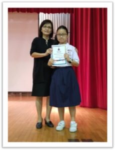 The performers receiving their certificates after their performances from our Principal , Mdm Foo.