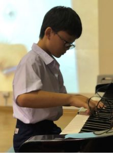 Isaac Toh Kang Lei (3 Gracious), showcasing his piano skills.